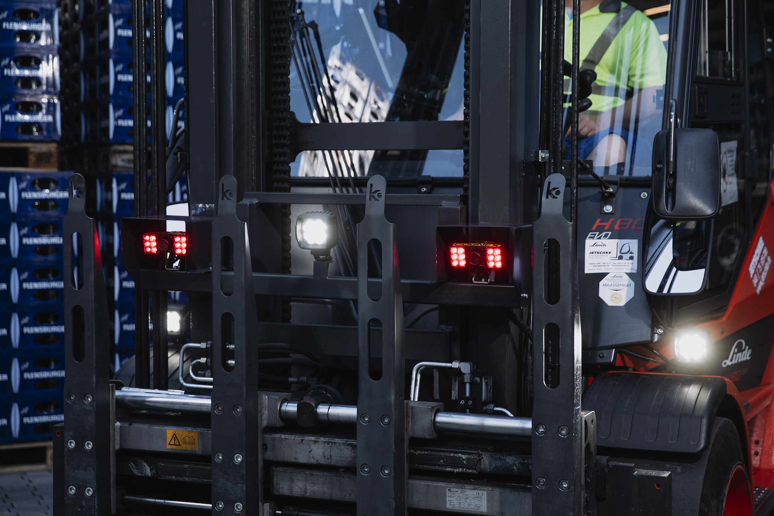 Forklift in a brewery warehouse with barcode readers mounted on it