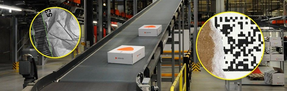 boxes with damaged barcodes on a conveyor belt