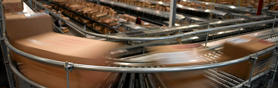 high speed parcels on a metal conveyor line in distribution center