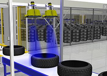 Cognex Dataman readers mounted above tire conveyor belt piled tires in background