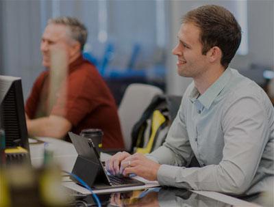 Two men attending Cognex workshop event
